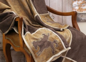 """Bucking Bronc"" Throw. Soft and oversized, featuring appliqued & embroidered ""bucking bronc"" and other western designs in each of the 4 corners. Matches our Bucking Bronc Comforter Set. Microfiber suede lined with a faux shearling. 54″ X 68″"