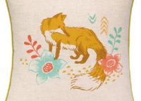 Sarah Watts. Wildflower Fox Printed Pillow. Charming fox among wildflowers. Aqua, salmon, green and off white colors. Reverse is aqua with colorful arrow motifs. 20″ x 20″