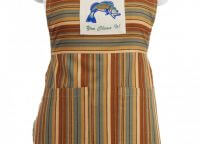"Cordwood Fish Apron with jumping fish motif declaring ""You catch it, you clean it."" Striped with earthy colors tan, brown, and blue. Two pockets"