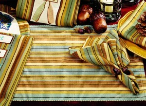 Cordwood Placemat. Versatile and attractive, multi-striped with colors of sky blue, wood brown, gold and cream.