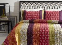 BT Home Emma quilt set. Mountain Bohemian bedding, saddle stitch hand-quilted. Dark purple, pinks, gold, limon green