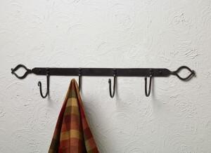 Large Crisscross Iron Hooks Bar. Vintage look lends itself to a myriad of décor uses. Round crisscross designs at each end. Made of iron. 4″H x 24″W x 3.25″D