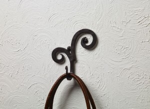 Iron Rams Horn Wall Hook. Perfect rustic western charm wall décor made of wrought iron with decorative Rams Horn detail on top of the hook. 6.5″H x 6″W x 2.5″D