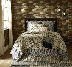 VHC Brands' Fleur-de-Lis Cavalier Chalet Quilt. French countryside enchantment in black, grey, and cream with stylized wildflowers