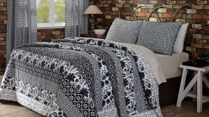 VHC Brands. Midnight Run Quilt Set. Eye-catching multiple black and white floral and diamond patterns. Stitch-in-the-ditch and echo quilting.