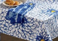Indigo Dahlia Tablecloth. Beloved Dahlia motif in cool Indigo hues, with golden floral centers and white petals. 84″ x 60