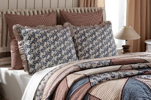 VHC Brands. Laketime Cottage Blues Luxury Quilt. Attractive patchworked hues of summer lake blue and tan sandy beaches.