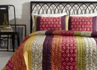 BT Home Emma quilt set. Mountain Bohemian bedding, saddle stitch hand-quilted. Dark purple, pinks, gold, limon green