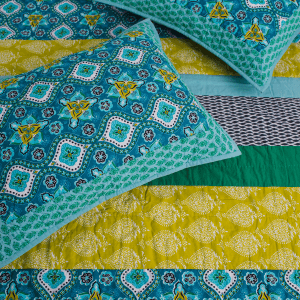 BT Home. Addison Quilt Set. Appealing Bohemian patterns of cool blue and serene green. Hand quilted with stitch in the ditch and channel quilting. Twin, Queen, King sets